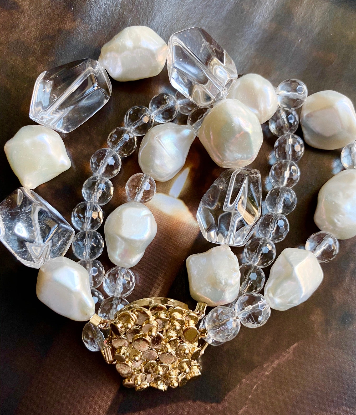 The bracelet made of crystal clear quartz and baroque pearls brings the sparkling joy and freshness. The unique gold plated silver clasp makes this piece made for the keeps