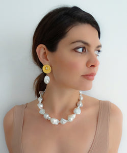 Oversized baroque pearl necklace, simple yet vibrant and effective. Each and every pearl is powerful and rare in its beauty. Goldplated silver clasp. Bold and brilliant