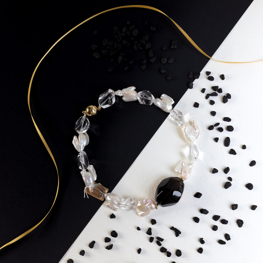 Everybody will notice this oversized smokey and crystal quartz beauties attached with keishi pearls of unexpected shape. Gold plated silver magnetic clasp. It is time to shine!