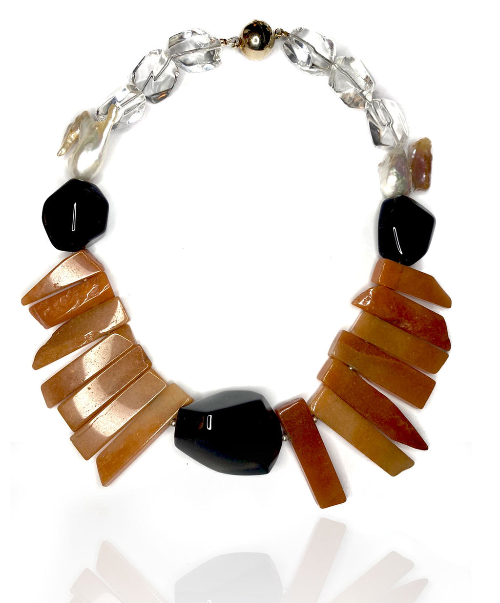 Enjoy the warmth of caramel agate with smokey brown and crystal quartz and two carefully selected keishi pearls. Gold plated sterling silver magnetic clasp.