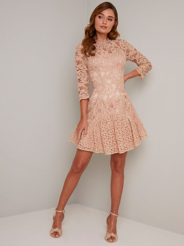 Lace Overlay Long Sleeved Dress In Rose Gold