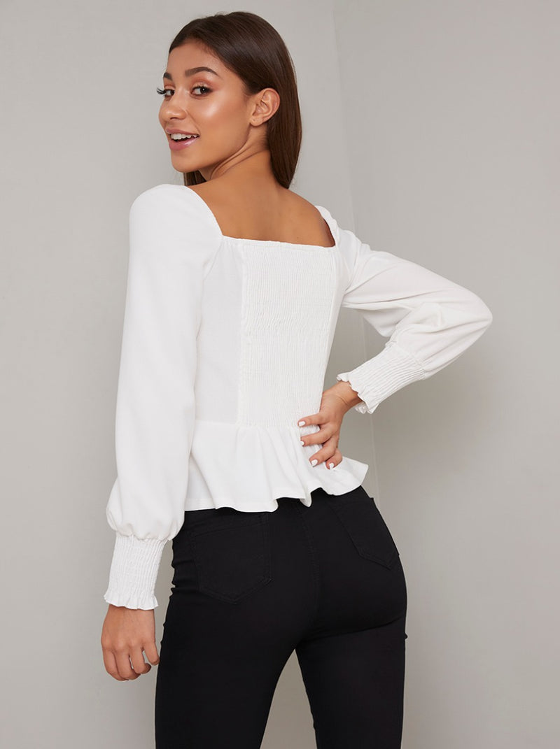 Puff Sleeved Button Peplum Top in White