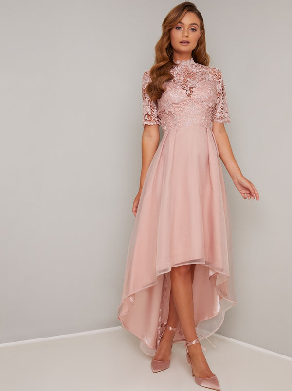Short Sleeved Sheer Lace Dip Hem Midi Dress in Rose Gold