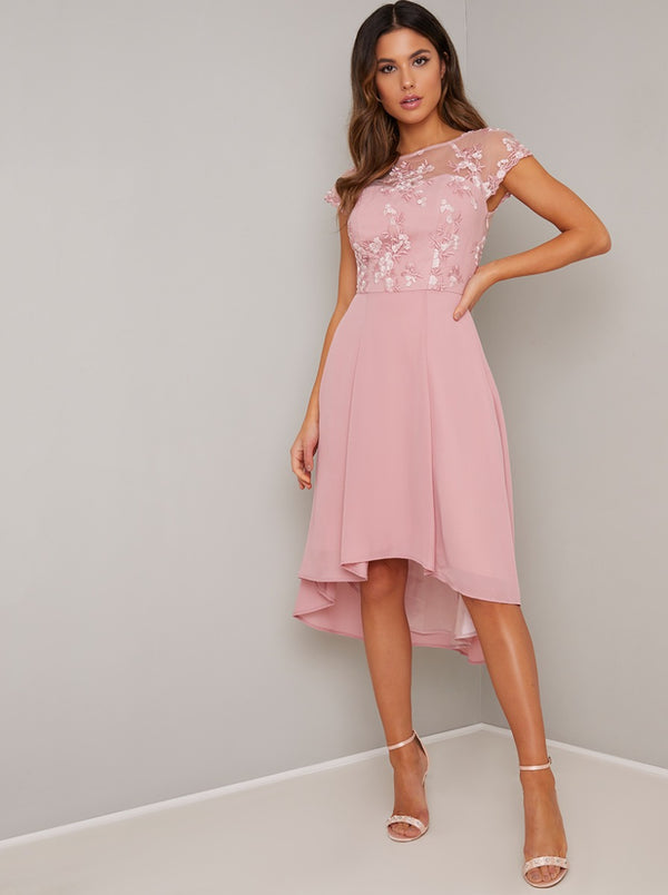 Cap Sleeved Lace Embroidered Dip Hem Dress in Pink