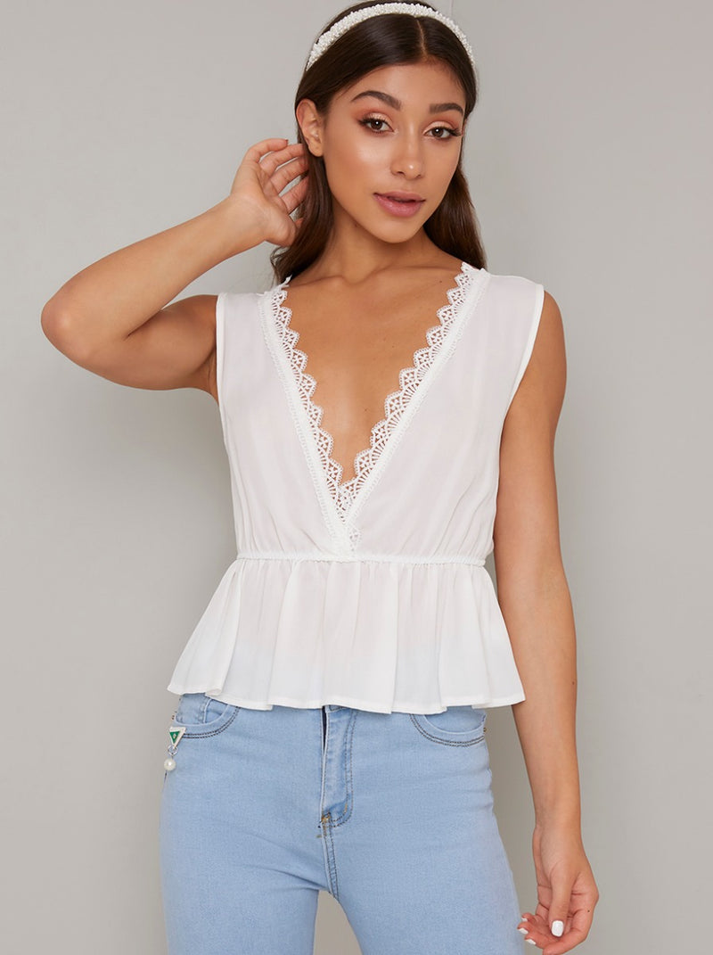 Lace Edged Peplum Top in White