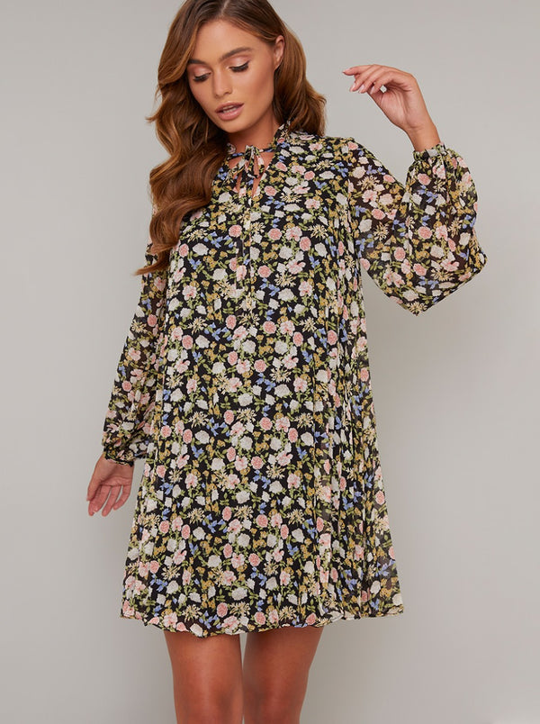 Floral Print Long Sleeved Swing Dress In Black