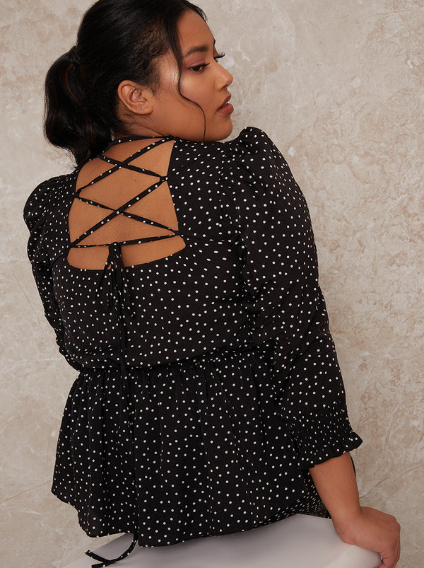 Plus Size Polka Dot Peplum Top in Mono