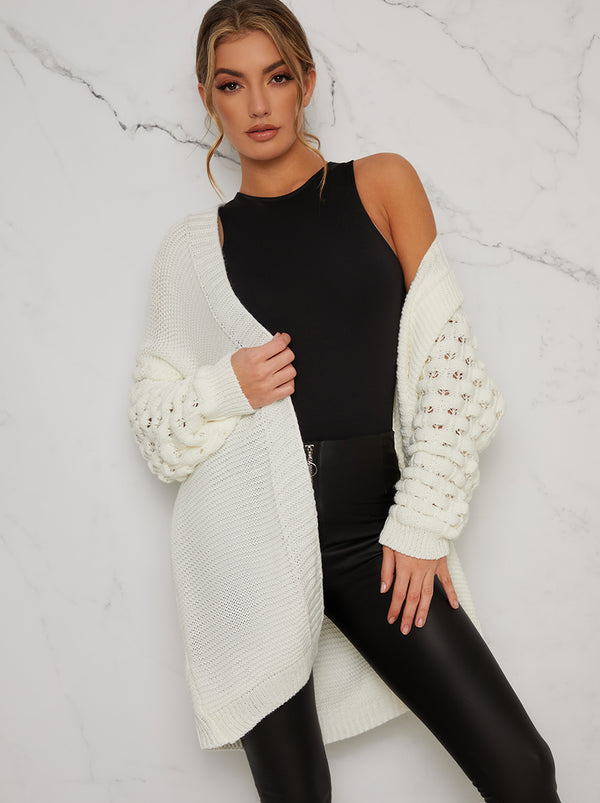 Knitted Balloon Sleeved Cardigan In Cream