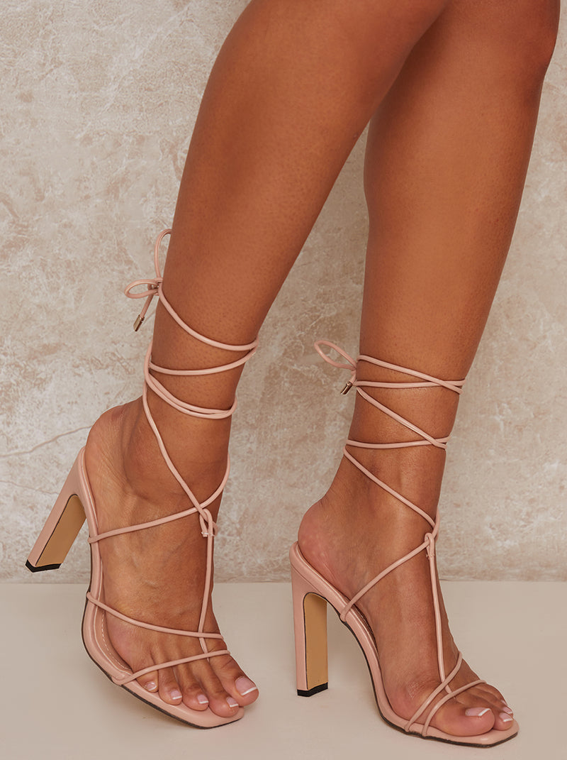 Square Toe Strappy Lace Up Mid Heel Sandal in Nude