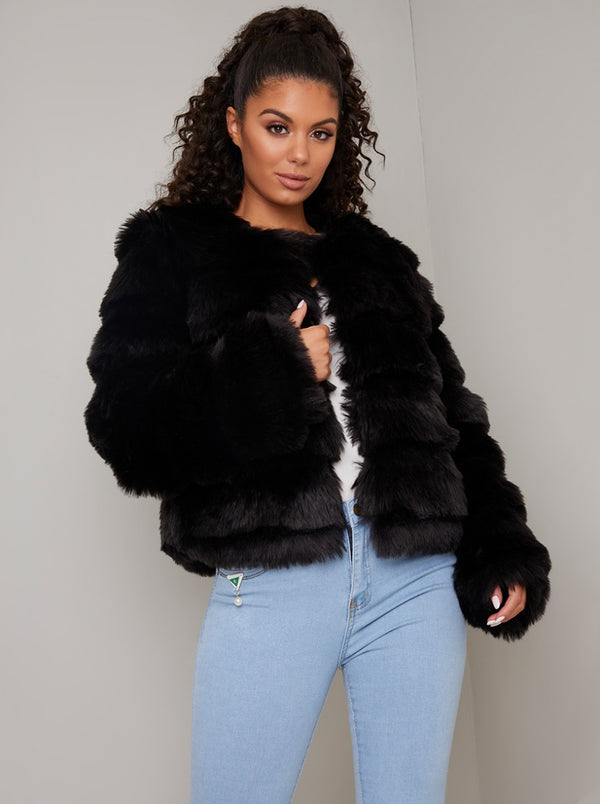 Stepped Faux Fur Coat in Black