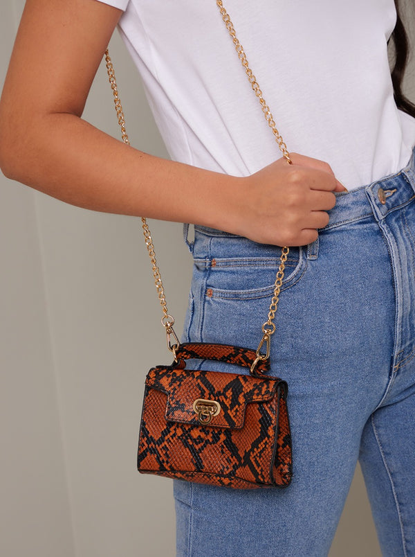 Faux Snakeskin Micro Shoulder Bag in Brown