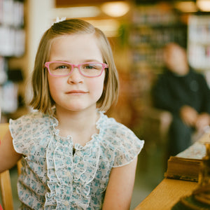 Young girl with cool purple glasses