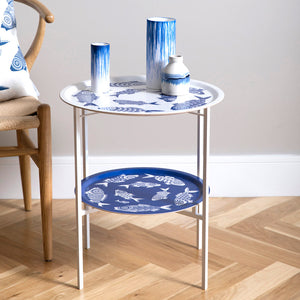 White and blue folding coffee table by Asta Barrington