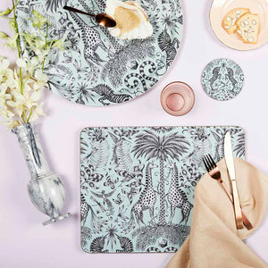 Green placemat featuring giraffes designed by Emma J Shipley
