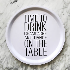 Tray with time to drink champagne and dance on the table text