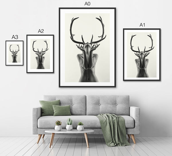 A size art prints framed to scale in a modern living room