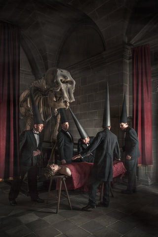 Rembrandt anatomy lesson with coneheads and an elephant skeleton