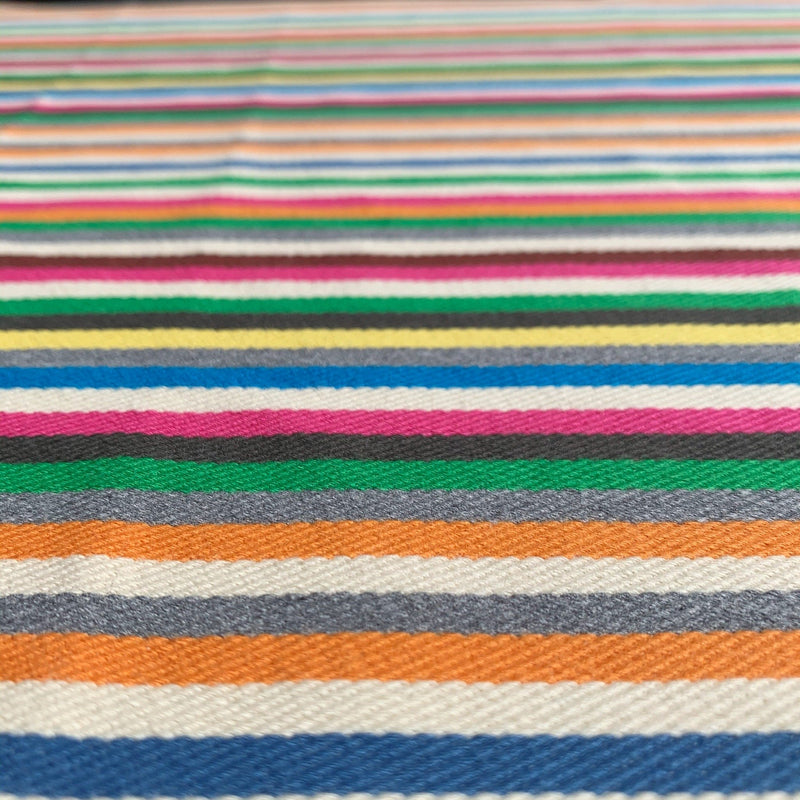 closeup of stripes to Rainbow striped twill denim