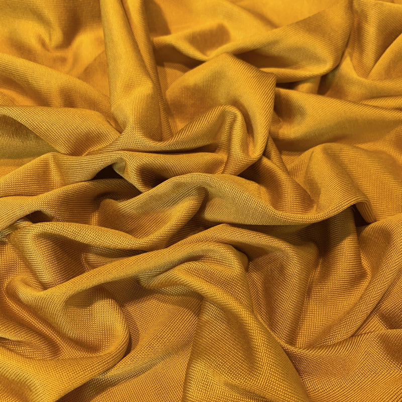 Golden Mustard Jersey knit scrunched to show type of volume and sateen finish