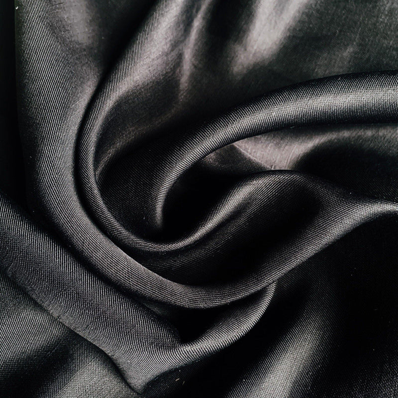 Black Sateen silk wool twill swirled to show light and texture