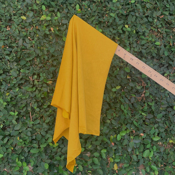 Golden Mustard Rayon Jersey draping form a ruler