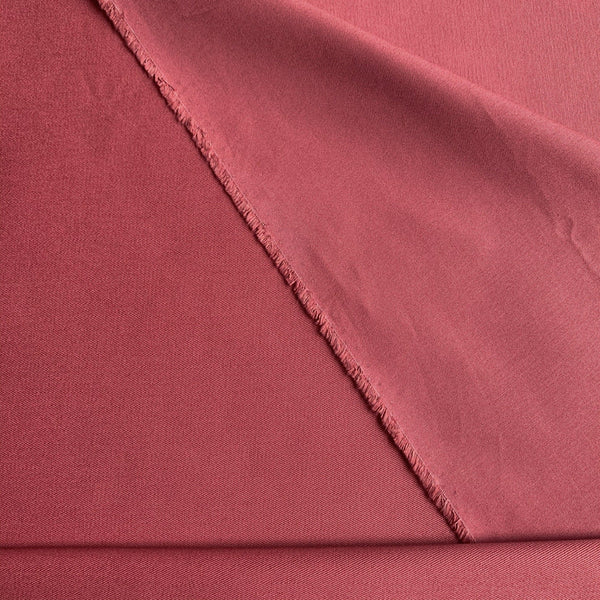 Rose colored organic cotton twill flat texture