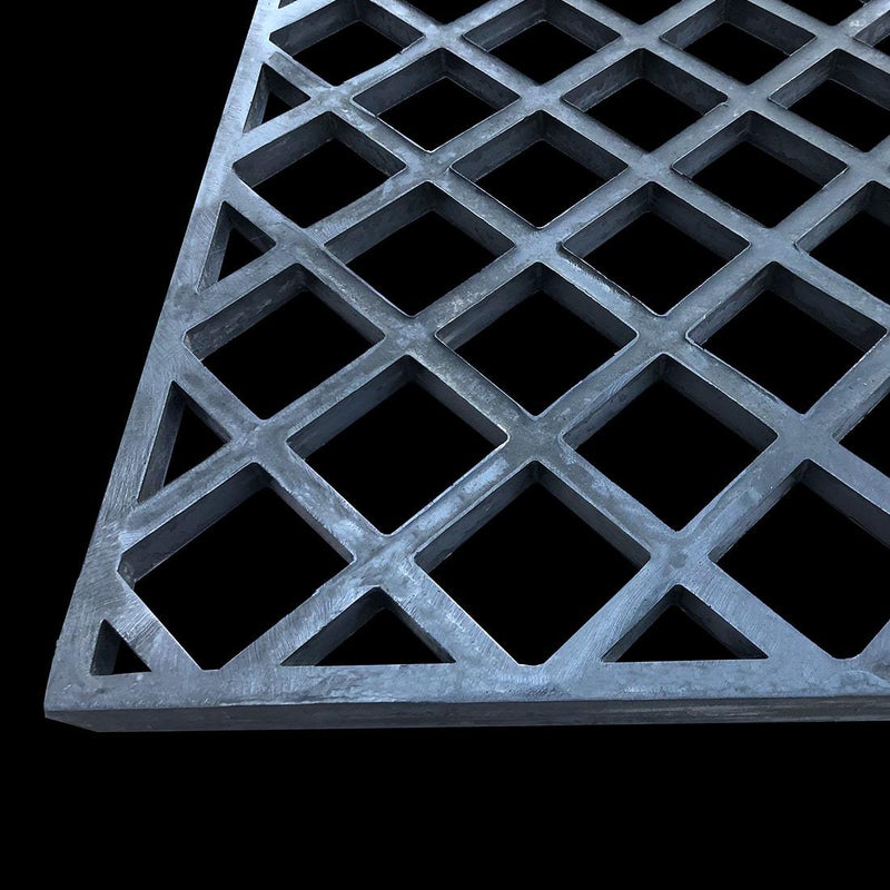 dark gray diamond mesh grating on black background