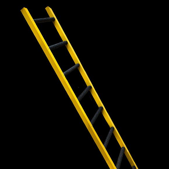 Yellow ladder on black background