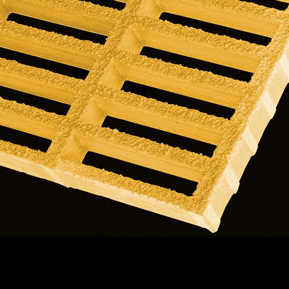 yellow gritted rectangular mesh grating on black background