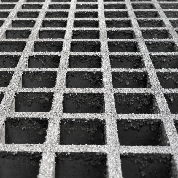 light gray gritted square mesh on black background