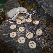 Load image into Gallery viewer, Hazel wood Elder Futhark rune set hand-engraved in pyrography and handcrafted organic linen pouch Misty Stroll