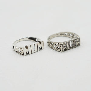 Pair of Vintage Sterling Silver Mum rings on a white background.