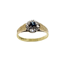 Load image into Gallery viewer, Vintage 18K gold ring- Band is ridged. Centre flower- with sapphire centre and diamonds set as petal surround. Hallmarks on inner band. White background.