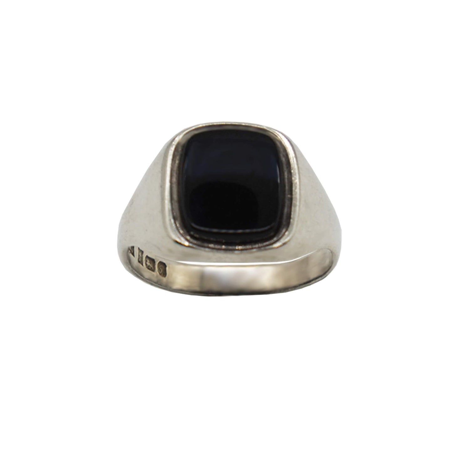 Close up Vintage Sterling Silver Ring with rounded corners rectangle black onyx stone. Hallmarks on inner band, background white.