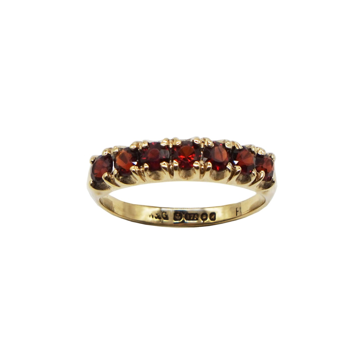 Close up Vintage 9K Gold Garnet Half Eternity Ring. 7 set  Red Garnet stones. Hallmarks can be seen on inner band. Background white.