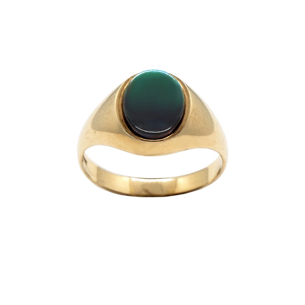 Vintage 9K gold Signet ring, with oval semi precious green onyx stone. White background.
