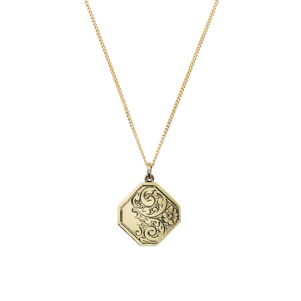 Vintage 9K gold Octagon Locket with flower scroll design, on 9K fine curb chain. White background.
