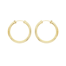 Load image into Gallery viewer, Close up product shot of 9K gold tube hoop earrings on a white background