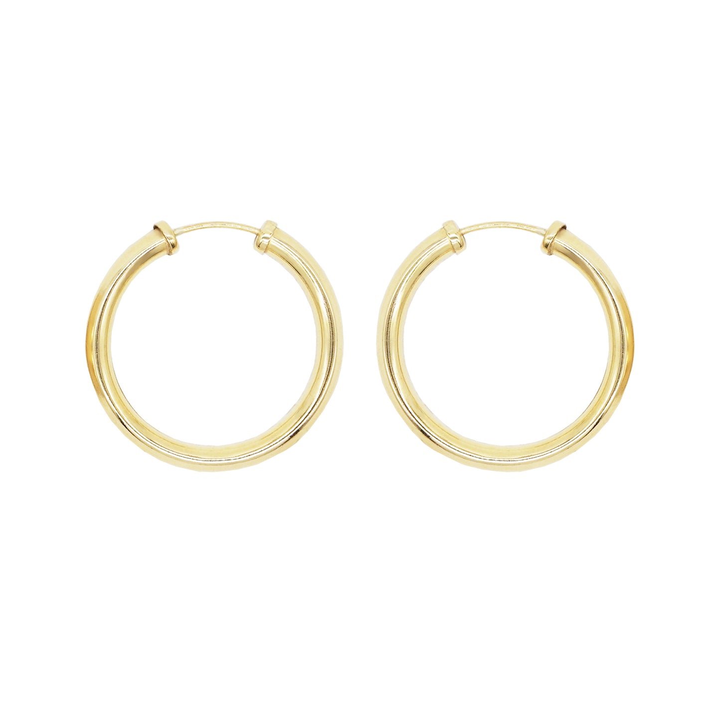 Close up product shot of 9K gold tube hoop earrings on a white background
