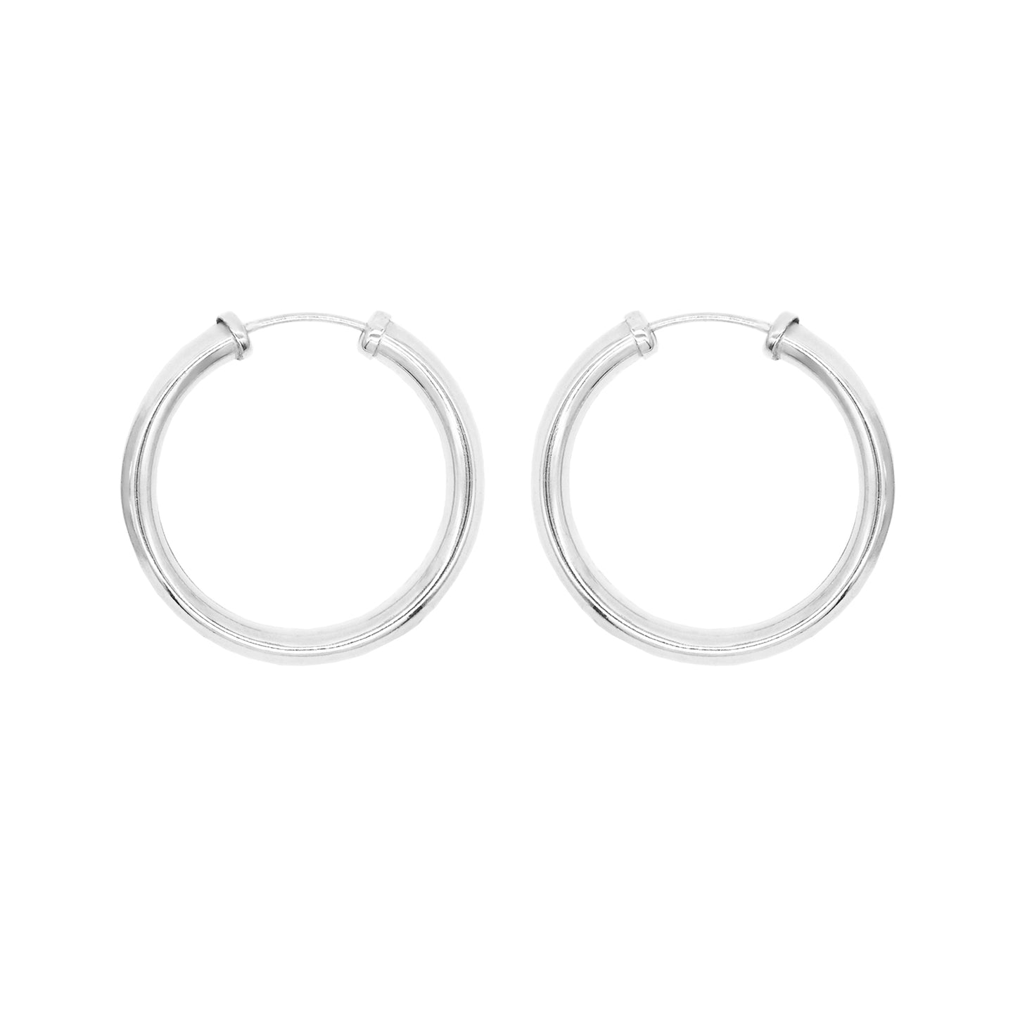 Pair of sterling silver tube hoop earrings with thread through closure. White background.