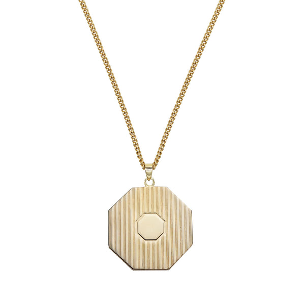 PAWNSHOP GOLD PLATED STERLING SILVER HEXAGON PENDANT ON A WHITE BACKGROUND.