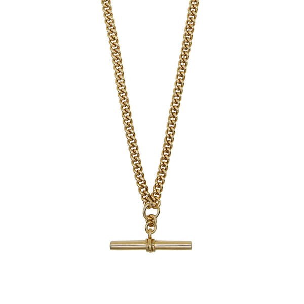 Close up of Pawnshop gold plated sterling silver T bar necklace. Curb chain detail with a T bar charm feature.