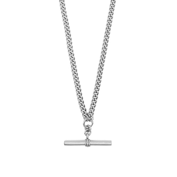 Close up of Pawnshop sterling silver T bar necklace. Curb chain detail with a T bar charm feature.