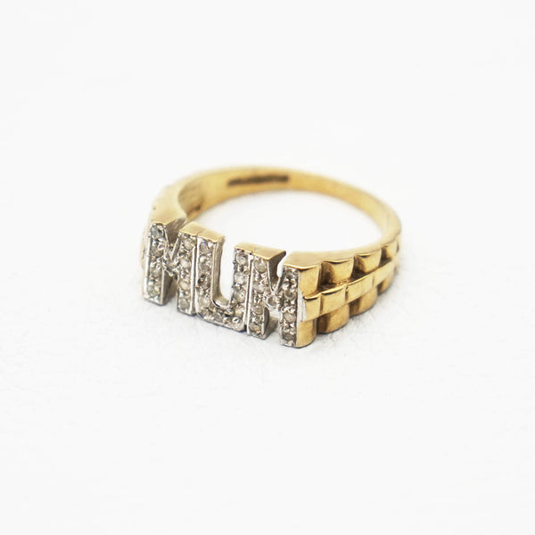 Side view showing textured band of Pave MUM ring