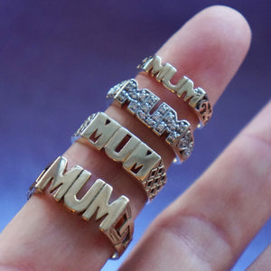Close up 4 Vintage Mum Rings on a finger.