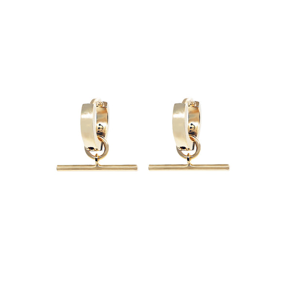 Pair of small chunky pawnshop gold plated sterling silver hoop earrings with T Bar Charm. Pawnshop 3 ball logo in black on inner hoops. Shot on a white background.