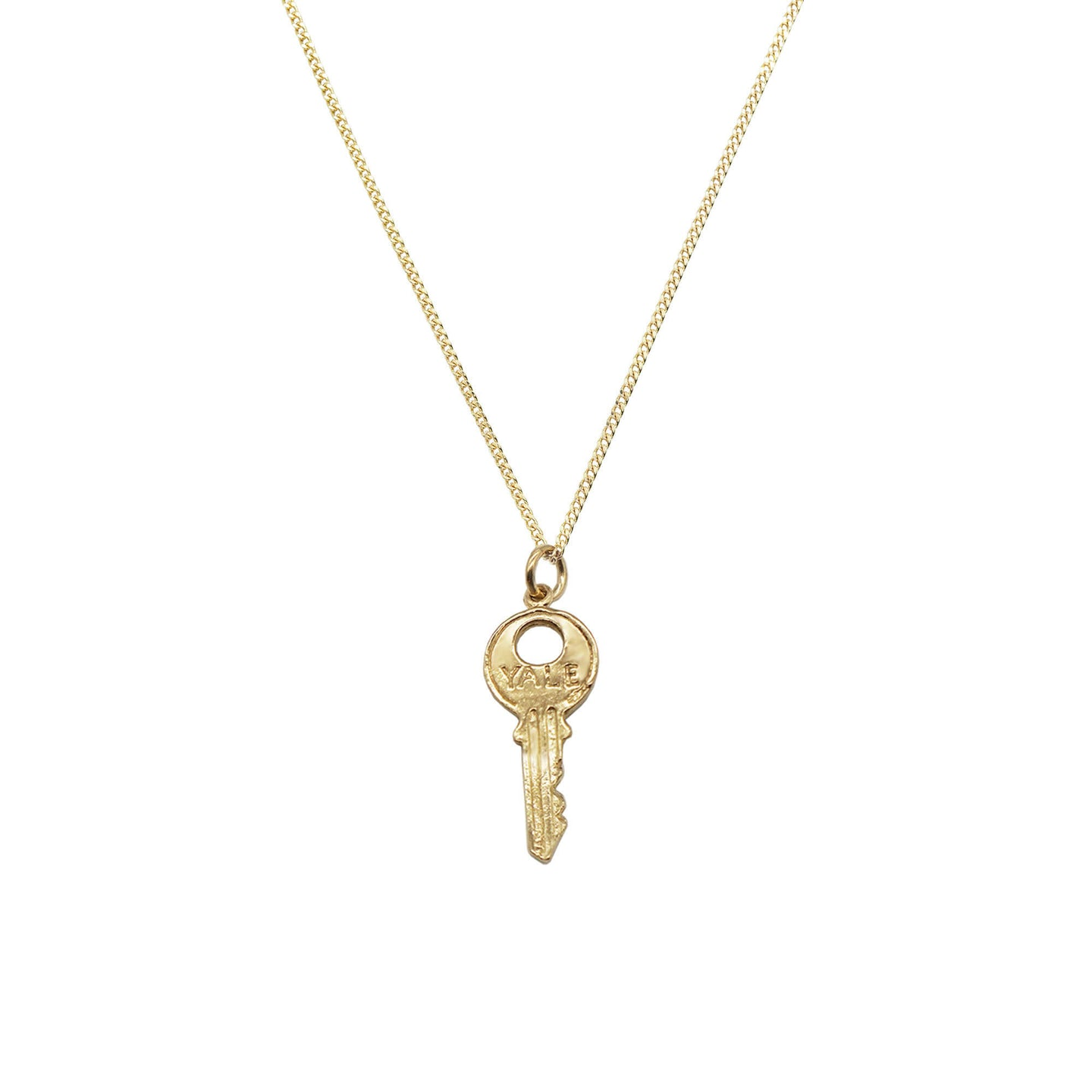 Vintage 9K Gold Key Charm Neckace on a fine curb chain. Key has the word 'YALE' engraved on front. White background.
