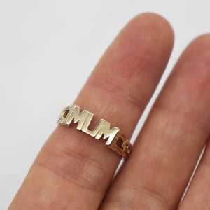 Close up of MUM ring on models finger.