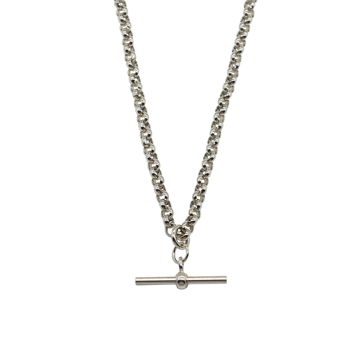 Close up Vintage T Bar Necklace on Belcher Chain in Silver. T Bar Charm is smooth. Background colour white.