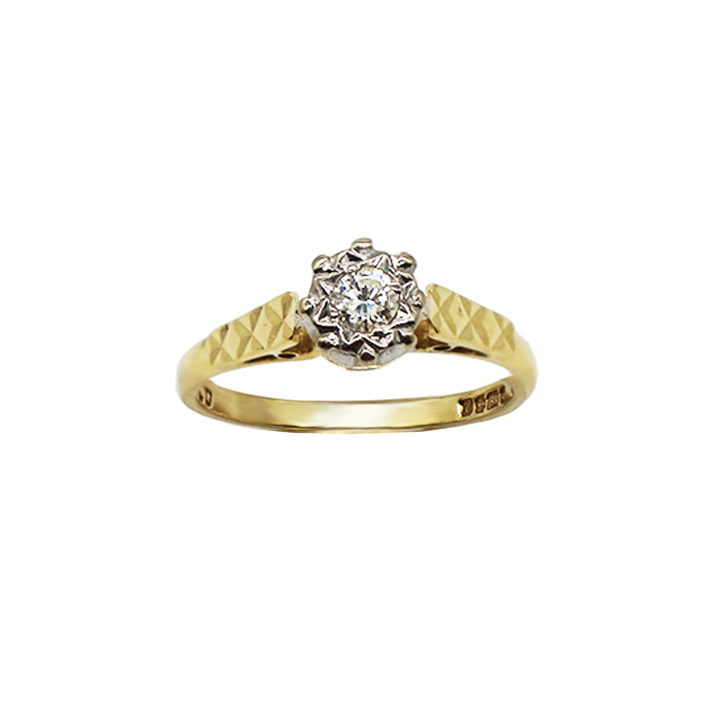 Vintage 18K Gold ring, with Diamond Solitaire stone cset in a flower design. The band is textured/ cross. Hallmarks can be seen on the inner band. Background is white.
